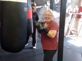 F.R.E.S.H. boxing group participant posing for photograph at a boxing gym/