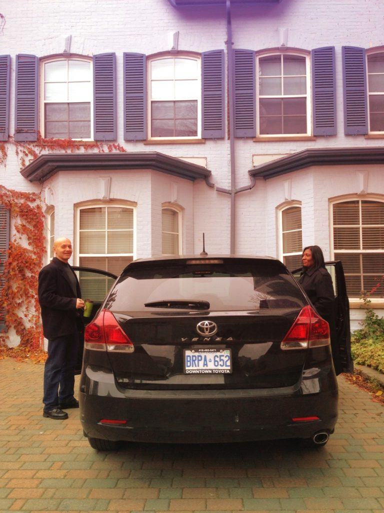Two Gerstein Crisis Centre Community Crisis Workers entering a black car